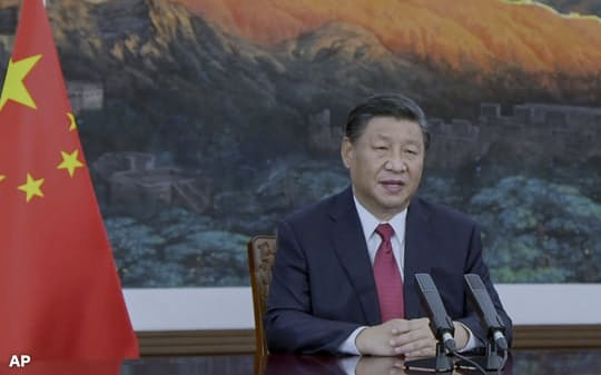 国連総会一般討論でビデオ演説する中国の習近平国家主席=AP