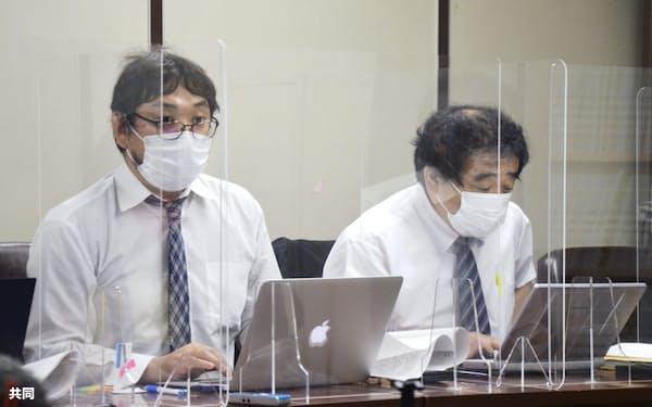 東京高裁判決後に記者会見する、スリランカ出身の男性2人の代理人弁護士ら(22日、東京都千代田区)=共同