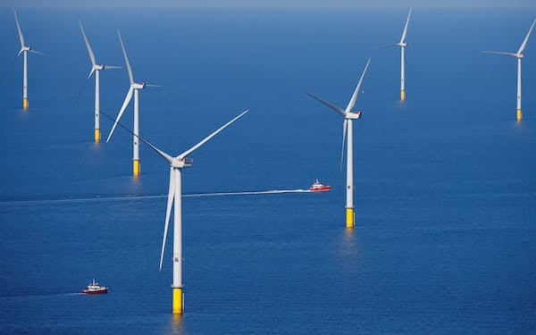 FILE PHOTO: A support vessel is seen next to a wind turbine at the Walney Extension offshore wind farm operated by Orsted off the coast of Blackpool, Britain September 5, 2018. REUTERS/Phil Noble/File Photo