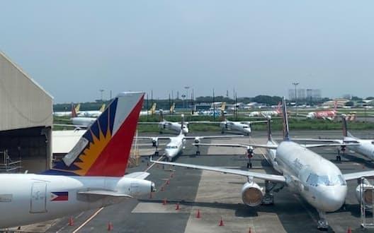 フィリピン航空は米国で連邦破産法11条適用を申請した(空港に並ぶ同社機材)