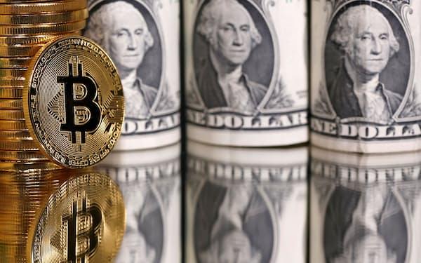 ドルなどの法定通貨に裏付けされたステーブルコインの存在感が増している=ロイター