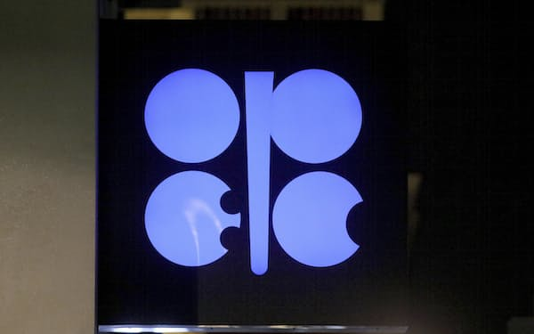 FILE - In this Dec. 19, 2019 file photo, the advertising label of the Organization of the Petroleum Exporting Countries, OPEC, shines at their headquarters in Vienna, Austria. The OPEC oil cartel and allied countries are meeting to decide on production. The meeting is being closely watched because oil markets are tight and the price of crude is just off a three-year high as the global economy bounces back from the pandemic. (AP Photo/Ronald Zak, File)