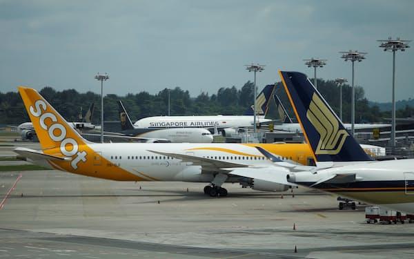 国際往来を順次再開、経済回復につなげる(シンガポールのチャンギ国際空港)=ロイター