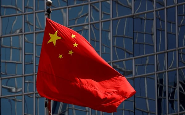 FILE PHOTO: The Chinese national flag is seen in Beijing, China April 29, 2020. REUTERS/Thomas Peter/File Photo