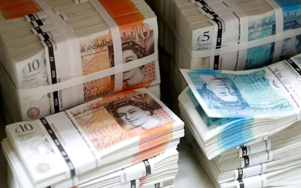 英イングランド銀行の早期利上げ観測がポンドを押し上げている=ロイター