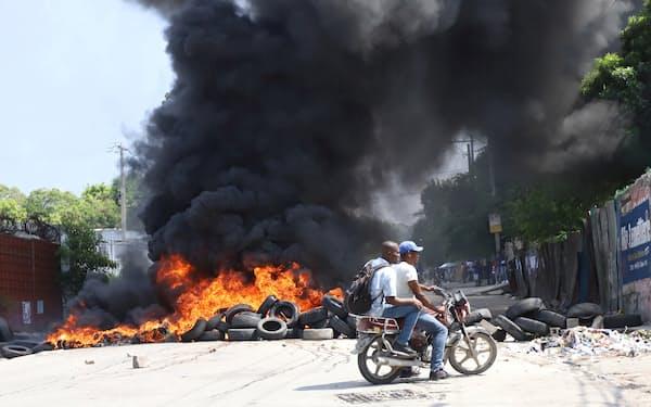 ハイチでは誘拐事件を受け、18日にストライキとデモが起きた(首都ポルトープランス)=ロイター