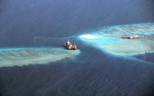 中比首脳会談の共同声明では、中国の主張を否定した南シナ海を巡る国際仲裁裁判所の判決への言及を避けた=共同
