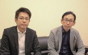 写真2 グランキューブの設計者。先端の防災機能を盛り込んだ三菱地所設計の松田貢治氏(左)と海野宏樹氏(右)(写真:日経アーキテクチュア)