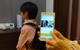 家庭向けIoTの一例。子どもが帰宅すると、スマートフォンに通知される