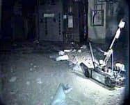 ロボットが撮影した福島第1原発1号機の原子炉建屋1階=東京電力提供・共同