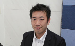 高尾理雄さん(39歳)。副業でシステムコンサル会社を経営する