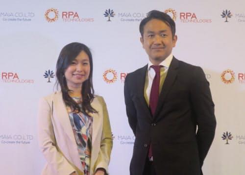 MAIAの月田有香CEO(最高経営責任者)とRPAテクノロジーズの大角暢之社長(右)