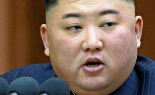 12日の最高人民会議で演説する金正恩委員長=朝鮮中央通信・ロイター