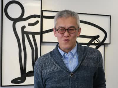 GMOブライツコンサルティングの加藤恭久IPソリューション部シニアコンサルタント。リラクセーションサロンのスタッフを副業としている