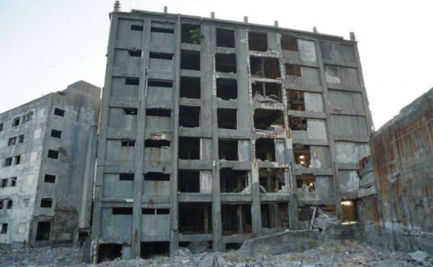 長崎県の軍艦島にある日本最古の鉄筋コンクリート造の30号棟(写真:ソナス)