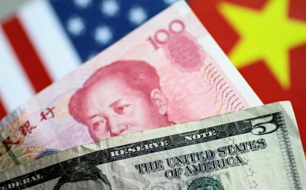 米財務省は貿易で有利になるよう意図的に通貨人民元を切り下げているとして、中国を「為替操作国」に指定した=ロイター