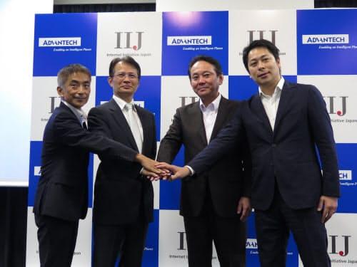 提携会見に臨むIIJと台湾アドバンテックの幹部