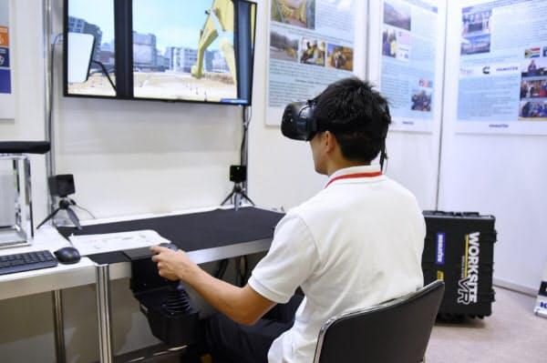 建設機械の訓練用VRシミュレーター「WorksiteVR Simulator」。コマツが「日本・アフリカビジネスEXPO」(パシフィコ横浜、開催期間2019年8月28~30日)で実機を披露した(撮影:日経 xTECH)