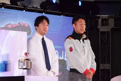 G-SATELLITEの開発を手掛けた東京大学大学院工学系研究科航空宇宙工学専攻特任研究員の青柳賢英氏(左)と、ガンプラの製作を担当した山中信弘氏(写真:久我智也)