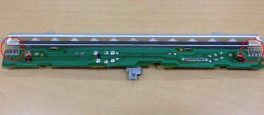 図2 焼損したものと同型のプリント配線基板。赤丸内が発熱した金属配線
