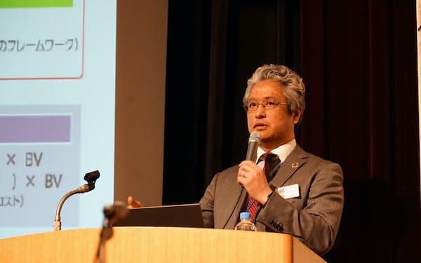 金融庁と東証主催のシンポで基調講演する金融庁の池田賢志氏(12月20日、都内)