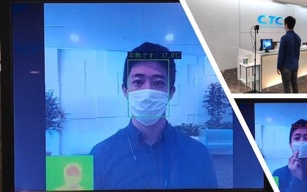 機器から0.5メートル程度離れた場所で数秒停止し、非接触で体表面温度を計測する。マスクを着用した状態で計測することが可能だ(出所:伊藤忠テクノソリューションズ)