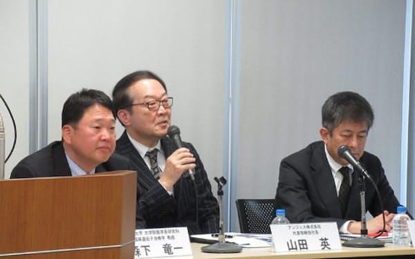 アンジェスは7月にも初期の臨床試験を始めるとしている(写真は3月、大阪大学と開発に乗り出すと発表した記者会見)