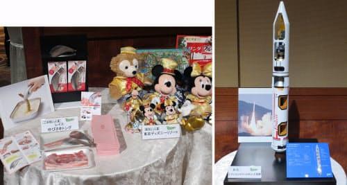 ご当地ヒット大賞は「レイエ ゆびさきトング」、周年ヒット大賞は「東京ディズニーリゾート」(写真左)。日経BP社の技術雑誌専門記者200人が選んだ注目技術のなかから選出された「技術賞」。1位は「イプシロンロケットの人工知能」(写真右)