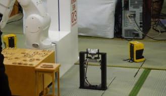駒を立てて置くための治具。電王手くんの左斜め前方に設置した