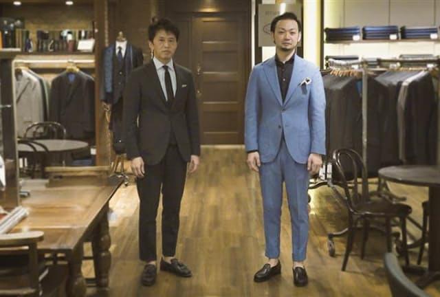 ともにアクティブスーツを着用。営業四部長の鈴木健一さん(左)は既製品で6万9300円。バイヤーの粟竹将さんはオーダーで5万5000円(素材によって価格は異なる)