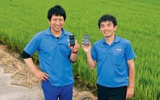 トヨタ自動車の新事業企画部企画総括グループ主任である喜多賢二(右)と、「豊作計画」を利用している農業法人、鍋八農産の代表取締役である八木輝治(左)(写真:上野英和)