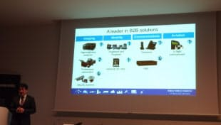 「ビジネス用途の機器でも強い」と報道機関向け発表会で説明 左端がArizono氏。スクリーンはパナソニックのスライド
