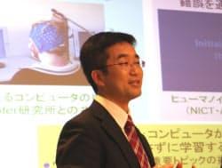 自身が取り組んでいる研究分野について説明する東京大学教授の杉山将氏