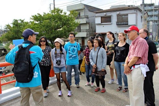 東京都大田区では外国人客向けのボランティアガイドを育成。都内には多様なボランティア制度で訪日客を支える制度がある