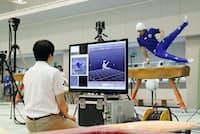 演技をセンサーで計測し体操選手の支援をする富士通(横浜市青葉区の日本体育大)