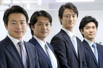 日本法人YCPジャパン(東京・港)のオフィスに並ぶディレクターの西村達一朗氏(右端)、グループCEOの石田裕樹氏(左端)ら幹部