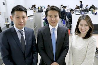 日本法人YCPジャパン(東京・港)のオフィスに並ぶパートナーの西口征郎氏(左)、ビジネスプロデューサーの谷内侑希子氏(右)、グループCEOの石田裕樹氏(中央)