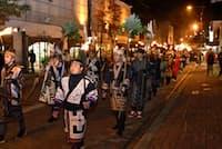 阿寒湖観光はアイヌ民族の文化が重要な要素となっている(伝統行事の「まりも祭り」)