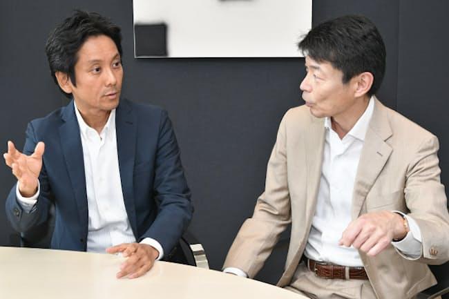 リクルートHDの峰岸真澄社長(左)とBCGの杉田浩章代表