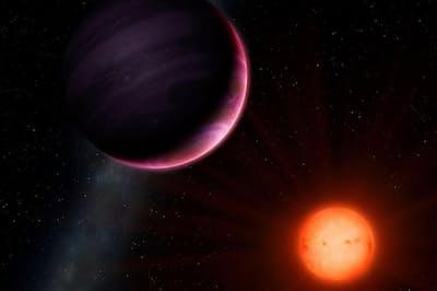 小さい恒星の周りを公転する巨大惑星NGTS-1bの想像図。(ILLUSTRATION BY UNIVERSITY OF WARWICK/MARK GARLICK)