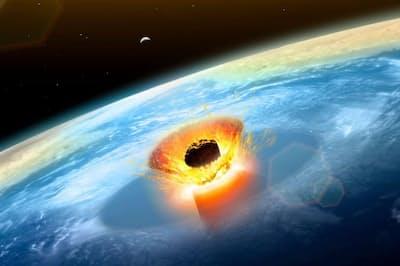 6600万年前にユカタン半島に衝突した巨大隕石は、恐竜の絶滅の主要な原因になったと考えられている。(ILLUSTRATION BY MARK GARLICK, SCIENCE PHOTO LIBRARY/ALAMY)