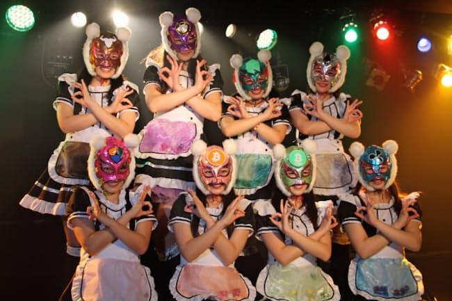 それぞれの担当仮想通貨をイメージしたマスクを着用する