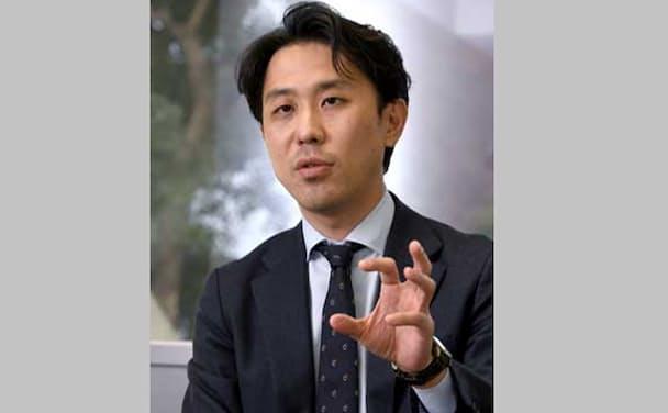 「インターネットを通じクレジットカードで決済する世界と、通貨そのものがデジタル化してブロックチェーン(分散型台帳)技術でやり取りされる世界では次元が異なる」(岩田氏)