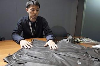 ゴアテックス シェイクドライを採用した新製品について語るゴールドウインの後藤太志氏。自身も100マイルレースを踏破するトレイルランナー