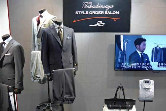 ブランドロゴなどで白と黒を基調として、赤色でビジネスマンの情熱を表現した