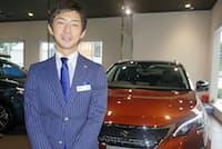 「今は若者に人気の多目的スポーツ車(SUV)を推している」という猪股さん。1~7月で既に昨年1年間の8割を売った