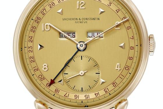1947年製コンプリートカレンダー腕時計 18KPG製 直径35mm 機械式手巻きムーブメント トリプル・ゴドロン装飾のケースサイド ティアドロップラグ 12時位置に曜日と月表示 税抜400万6800円 ※鑑定書と専用ボックス付き