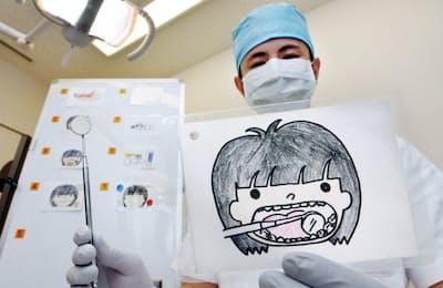 障害者の患者向けに治療内容を絵で伝えるカード(大阪市中央区の大阪歯科大学付属病院)