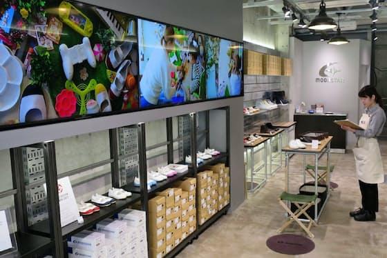 久留米工場をイメージした内装に仕上げ、ブランドの世界観を表現している