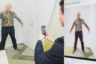 スマホで全身を撮影するだけで、服を着たままでも体のサイズが測れるBodygramを体験した津田氏。シャツを作るだけではない可能性を感じたという